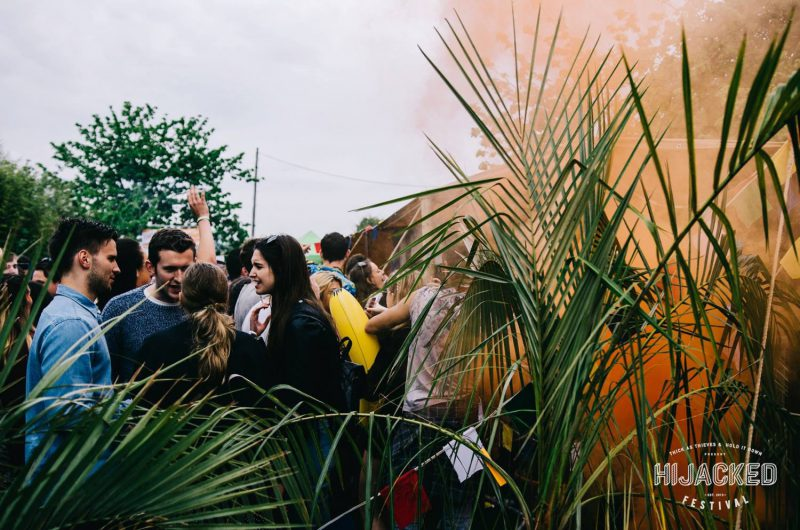 crowd surrounded by plants