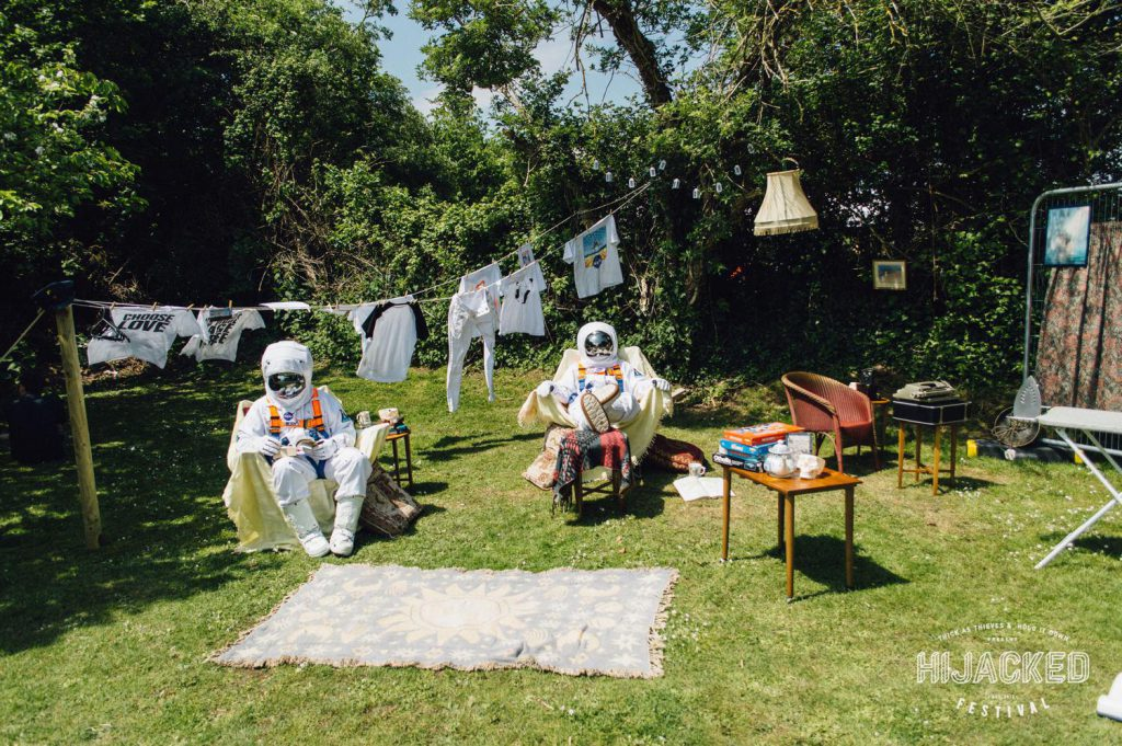 two astronauts in a garden